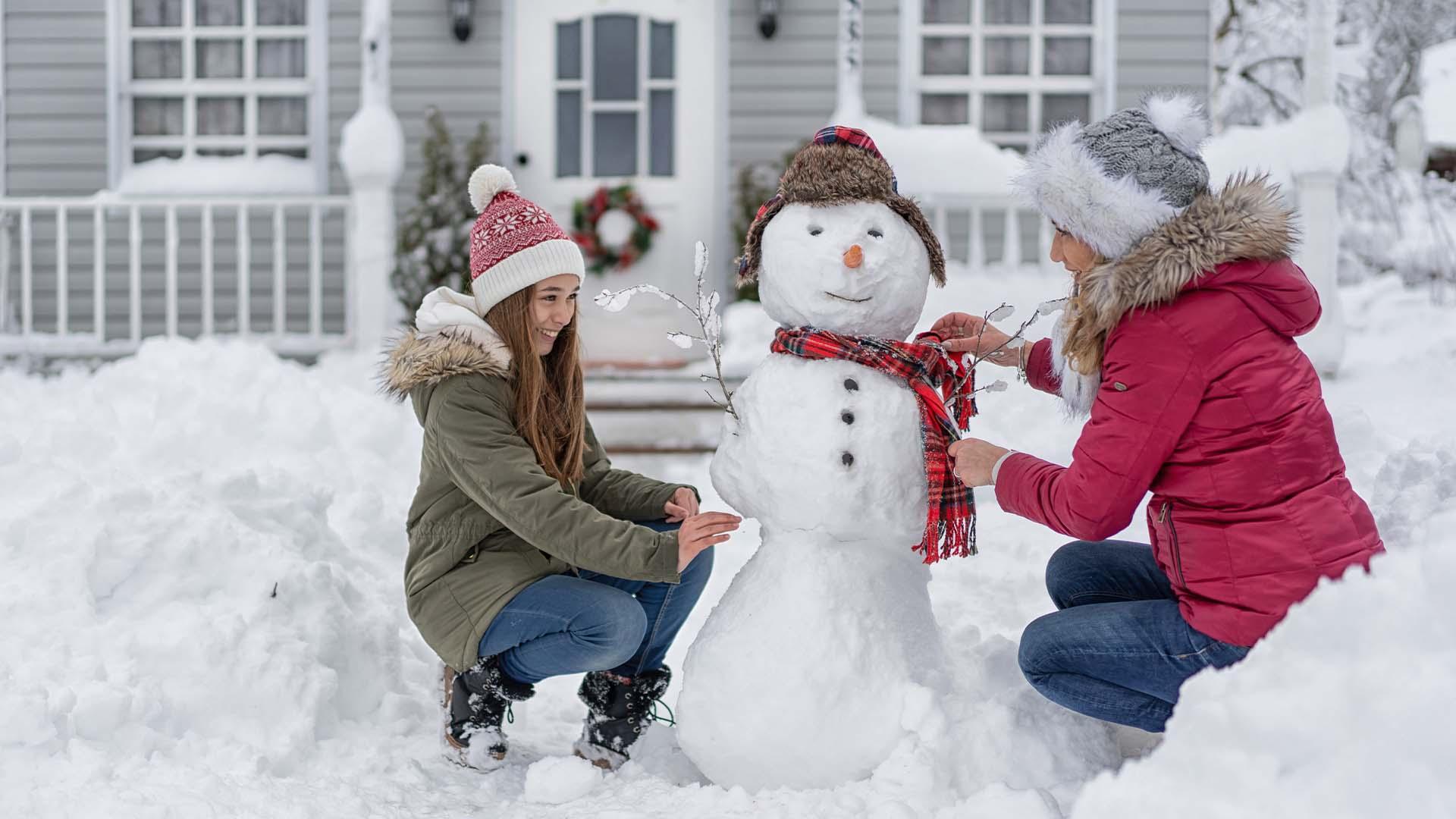 family in winter backyard